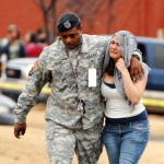 Photo by Dave Dieter / 1st Sgt. Robert Fearn walks his daughter, Janelle Lawrence, home after a shooting at Discovery Middle School on Feb. 5.
